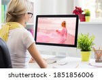 Small photo of Woman creating her own website on computer