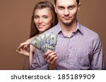 Loving couple are holding a large sum of money. Business concept. Family budget. - stock photo