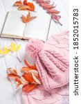 Book And A Warm Knitted Hat An...
