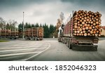 trucks loaded with spruce logs... | Shutterstock . vector #1852046323