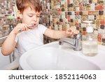 Close up of boy brushing teeth...