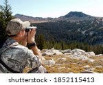 Hunter In Camouflage Using...