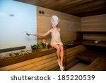 beautiful woman relaxing a sauna | Shutterstock . vector #185220539