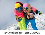 Happy Snowboarders Smiling And...