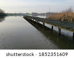 Side View Of A Wooden Jetty...