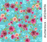floral pattern on blue... | Shutterstock .eps vector #185246456