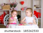 sisters making card | Shutterstock . vector #185262533