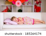 sweet little girl sleeping on... | Shutterstock . vector #185264174