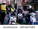Small photo of TAIWAN, TAIWAN - Oct 25, 2020: Police officers converge on a scene in Taipei, Taiwan with both electric and gas-powered scooters.