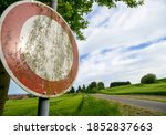 Stop Sign In Front Of A Paved...