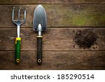 Gardening Tools On Old Wooden...