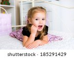 a little kid lying on the bed | Shutterstock . vector #185291429