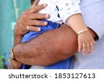 Man Holding Baby In His Arms