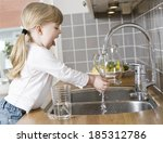 small girl in the kitchen... | Shutterstock . vector #185312786
