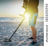 Man With A Metal Detector On A...