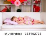 a little girl sleeping on a... | Shutterstock . vector #185402738
