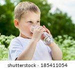 child drinking pure water in...   Shutterstock . vector #185411054