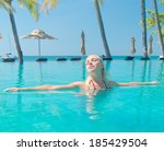 in a pool blonde woman  | Shutterstock . vector #185429504