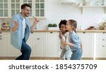 Overjoyed Father With Two...