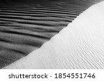 Black And White Sand Beach...