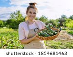 Smiling Woman With Basket Of...