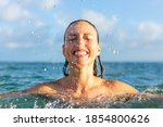 Cheerful Woman Enjoying The...