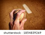 Pitcher Holding Baseball With...