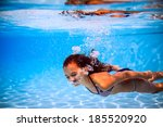 beautiful girl in the pool | Shutterstock . vector #185520920