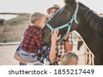 Family Enjoy Day At Horse Ranch ...