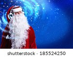 santa claus wearing headphones... | Shutterstock . vector #185524250
