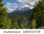 """Panoramic view from the Rest Area """"Zugspitzblick"""" at the Fernpass alpine road to the Zugspitze Mountain and Lake Blindsee, in Ausrria. Beautiful mountain scenery in Alps. - stock photo"""