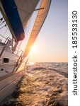 sail boat in an open sea at... | Shutterstock . vector #185533130