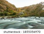 Small photo of Long exposure of the East Lyn River flowing past Watersmeet House in Exmoor National Park