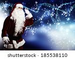 santa claus enjoying the sound... | Shutterstock . vector #185538110