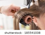 drying long brown hair with... | Shutterstock . vector #185541038