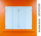 blue window on wall orange. | Shutterstock . vector #185542100