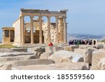 Small photo of ATHENS, GREECE - MARCH 27 , 2014 : Tourists in famous old city Acropolis Parthenon Temple. Its construction began in 447 BC in the Athenian Empire. It was completed in 438 BC