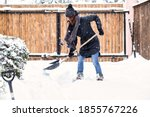 Woman With Shovel Cleaning Snow ...