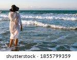 Girl Walking Along The Beach....
