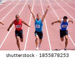 Male Sprinter Raising His Arms...