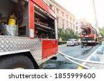 Firemen Wearing Uniform...