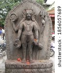Small photo of Four armed phallus metal statue in Katmandu, Nepal