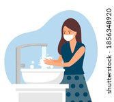 a woman washing her hands in... | Shutterstock .eps vector #1856348920