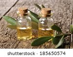 spa oil on a wooden table close ... | Shutterstock . vector #185650574