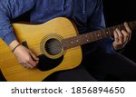 Man Playing Acoustic Guitar On...