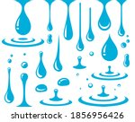 falling blue drops and splash... | Shutterstock .eps vector #1856956426