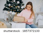 Cute Girl Holding Christmas...