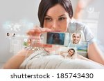 young pretty woman using social ... | Shutterstock . vector #185743430