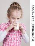 kid girl drinking yogurt or... | Shutterstock . vector #185747099