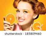 beauty model girl takes juicy... | Shutterstock . vector #185809460